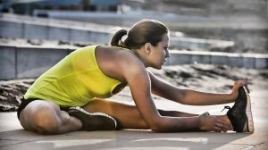 female-athlete-stretches-hamstring